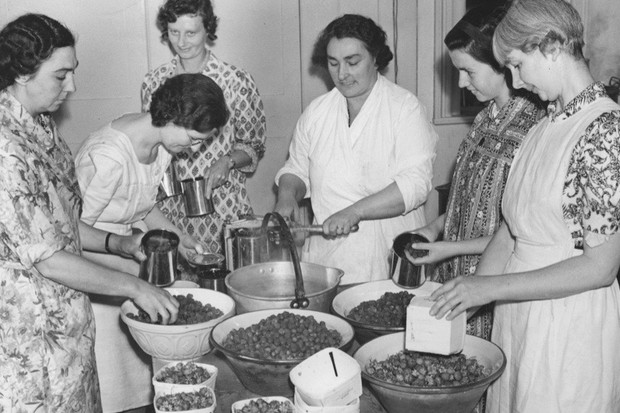 2nd July 1940:  A village 'jam depot' organised by the Women's Institute on behalf of the government to use up all excess home grown fruit. Villagers at Lewes in Sussex are busy making jam from redcurrants, raspberries and strawberries.  (Photo by Harry Todd/Fox Photos/Getty Images)